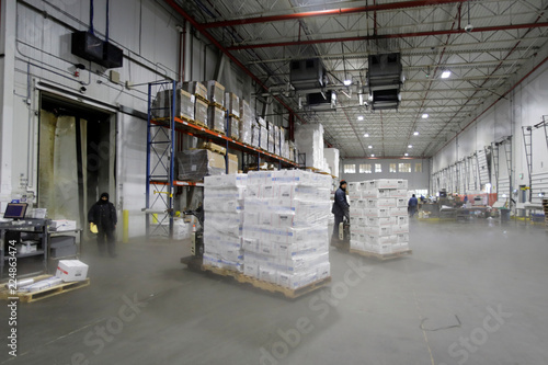 A forklift operator moves a pallet of imported frozen