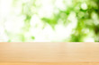 wooden plank table top with blur park green nature background bokeh light , for display or montage of product,Spring and Summer concept.