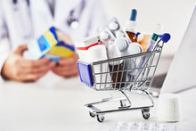 Mini Shopping Cart Full Of Medicines In Pharmacy