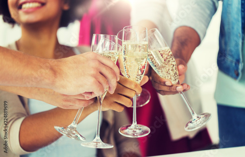 Obraz celebration, people and holidays concept - close up of happy friends clinking glasses of champagne at party - fototapety do salonu