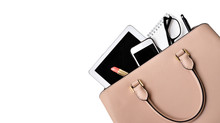Business Woman's Everyday-life Travel Accessories Flat Lay On White Background With Formal Beige Handbag, A Cellphone, Blank Notepad, Luxury Pen, Glasses And Lipstick, Copy Space And Clipping Path