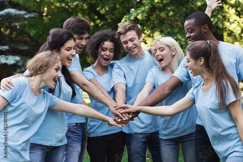 Fotografie, Obraz  Young happy volunteers outdoor meeting at park