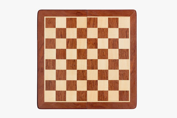 empty wooden chessboard isolated on white background, top view