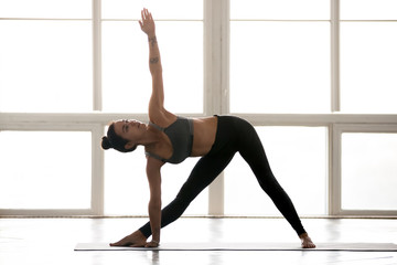 Young sporty yogi woman pra...