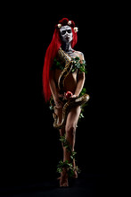 Nude Scary Zombie Woman With Red Hair Holding Long Snake Piton Around Neck And Big Red Apple.