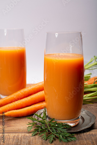 Foto op Canvas Sap Tasty healthy natural sweet vegetable drink, fresh organic carrot juice ready to drink in glass