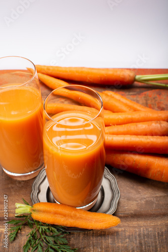 Tasty healthy natural sweet vegetable drink, fresh organic carrot juice ready to drink in glass