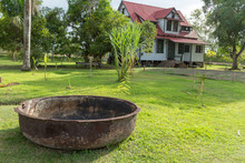 Colonial House In Plantage Frederiksdorp (Plantation) In  Surinam With Pot For Cooking Molasse