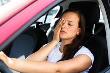 Woman Yawning Inside Car