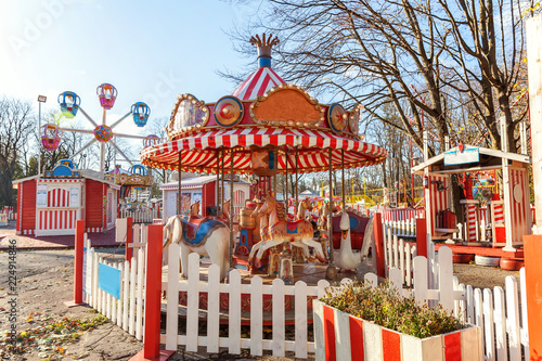 Foto op Plexiglas Amusementspark Children outdoor colourful vintage Merry-Go-Round flying horse carousel in amusement holliday park in city. Attraction detail horses and animals with lots gold paintwork on traditional retro carnival