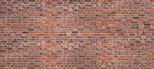 Dark Brown Or Red Old Brick Wall, Panorama. Brickwork Background Or Texture. Copy Space For Text Or Banner.