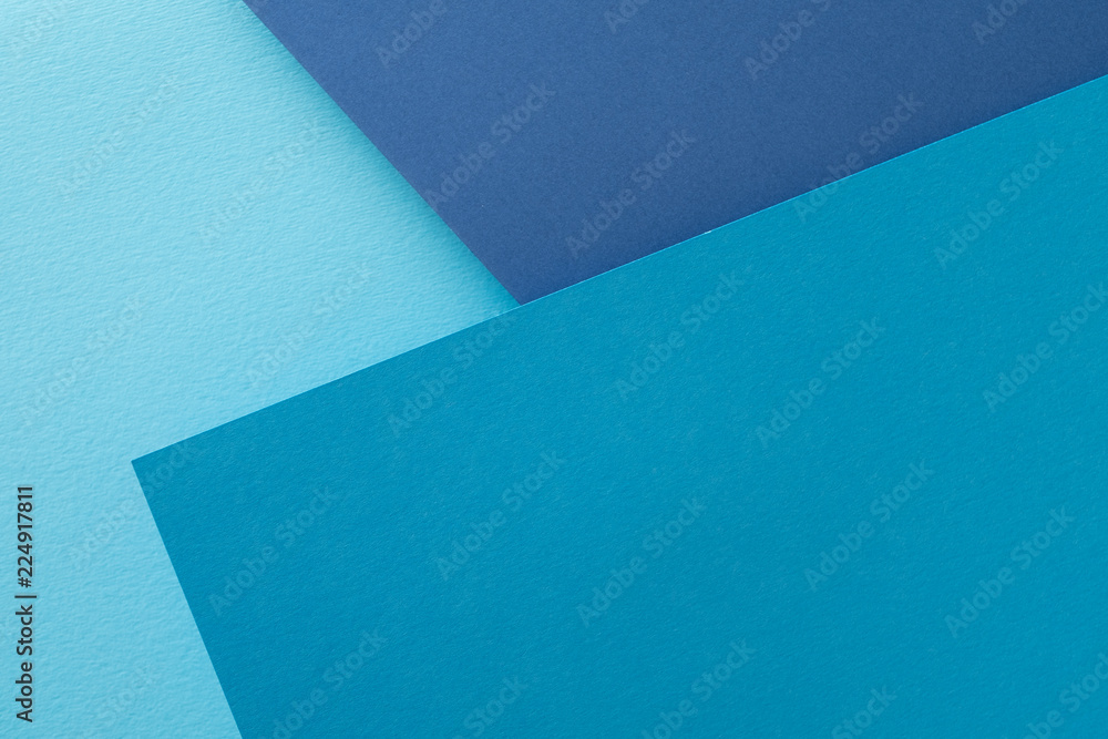 Fototapety, obrazy: layered construction paper background. shades of blue color abstract design with copyspace.
