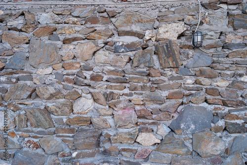 Foto op Aluminium Wand Old rough granite stone wall texture background closeup