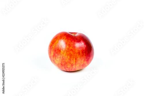 Fototapeta Dojrzałe jabłko z zielonym liściem obraz