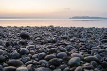 Stones On Beach At Sunset