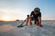 Man With A Metal Detector On A Sea Sandy Beach