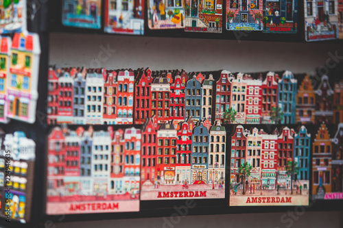 Foto  Traditional souvenirs from Amsterdam rows of Delftware porcelain Dutch style hou