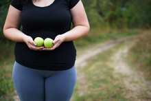 Healthy Snacking, Natural Eating, Property Nutrition, Lunch, Lifestyle, Weight Losing Concept. Overweight Woman With Two Green Apples In Hands