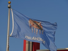 The Flag Of Oklahoma State Fly...