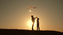 A Happy Family. Family In The Summer At Sunset Launch A Kite Into The Sky.