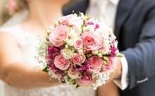 Bridal Bouquet With Bridal Couple