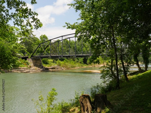 Photo  Old wooden bridge with steel railings at the War Eagle River in Rogers, Arkansas