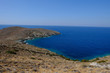 Island of Syros in greece, panorama of the kliff close to Delfini beach with land and sea.