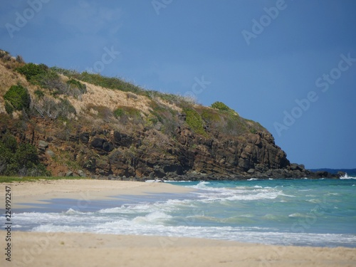 Fototapety, obrazy: Beautiful cliff lines overlooking white sand beach with clear blue waters