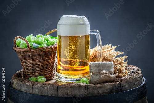 Staande foto Bier / Cider Cold light beer with bubbles on wooden barrel