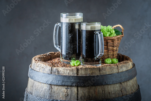 Tuinposter Bier / Cider Fresh pint of dark beer with wheat and hops