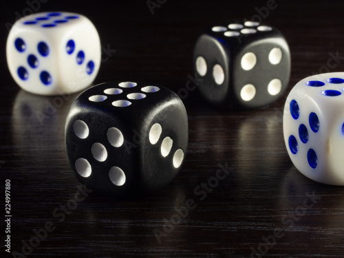 фотография  Table gambling with dice and backgammon in the evening with dim light on a dark