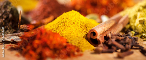 Fototapeten Gewürze Spice. Various indian spices and herbs colorful background. Assortment of seasonings, condiments