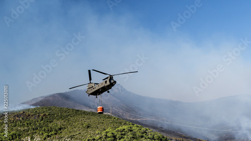 Tuinposter Helicopter Fire Fighting Helicopters in Action
