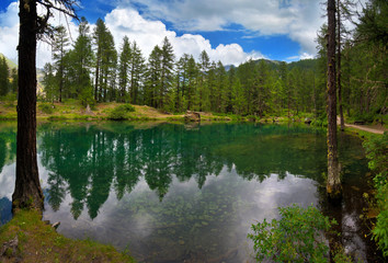 alpine lake in a pine forest in Rhemes Notre Dame, Valle dAosta, Italy,