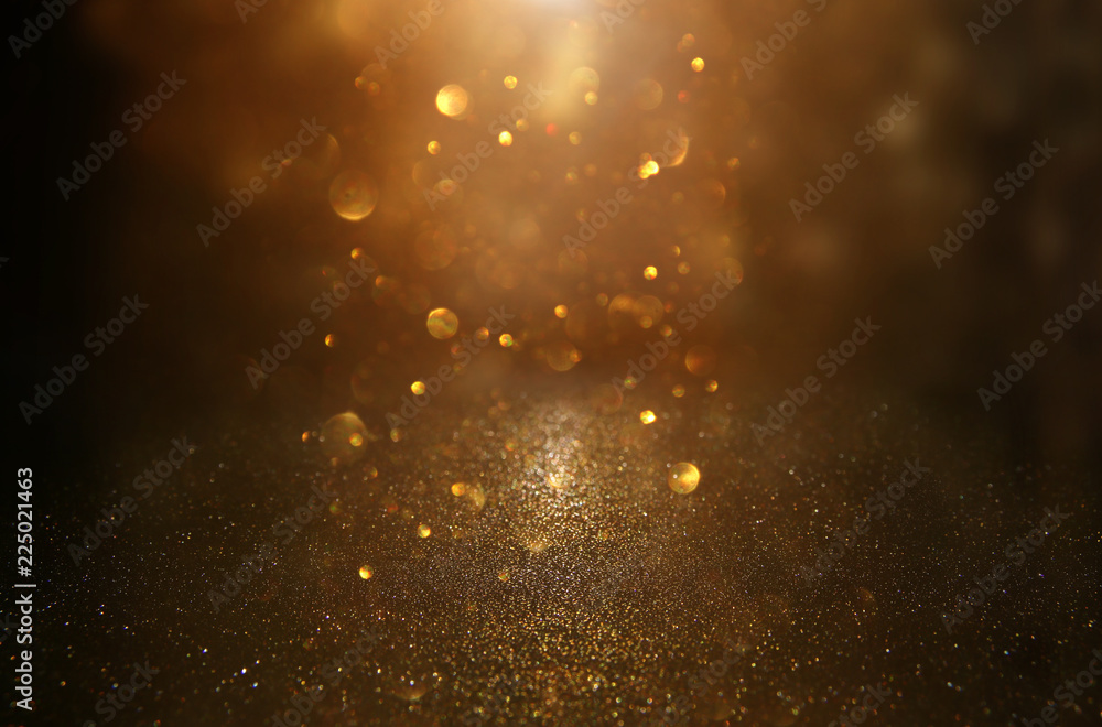 Fototapeta glitter vintage lights background. black and gold. de-focused.