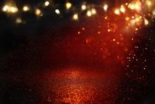 Red, Black And Gold Glitter Lights Background. Defocused.