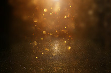 Glitter Vintage Lights Background. Black And Gold. De-focused.
