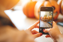Woman Artist Prepares For Halloween And Photographed On Smartphone His Work Painted Pumpkin