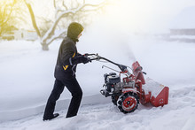 Young Man Removes Snow With A ...