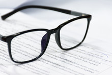 Reading Glasses On The Paper S...