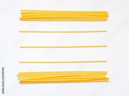 Fototapeta Dry spaghetti on a white background for the menu. Geometric background. Flat lay, copy space, top view obraz