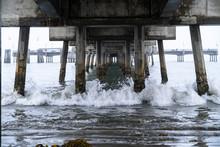 Waves Crashing Under Pier In California