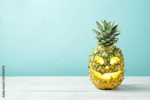 Halloween holiday concept with jack o lantern pineapple - 225060476