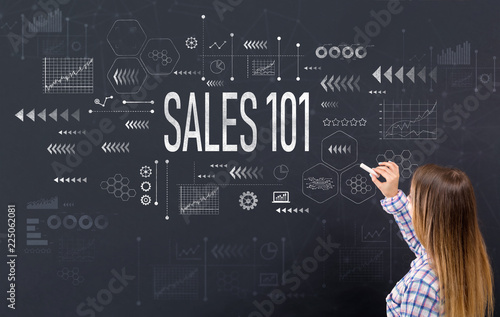 Sales 101 with young woman writing on a blackboard Canvas Print