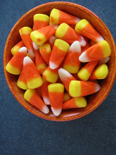 Colorful Halloween Candy Corn In Orange Bowl, Blue Background