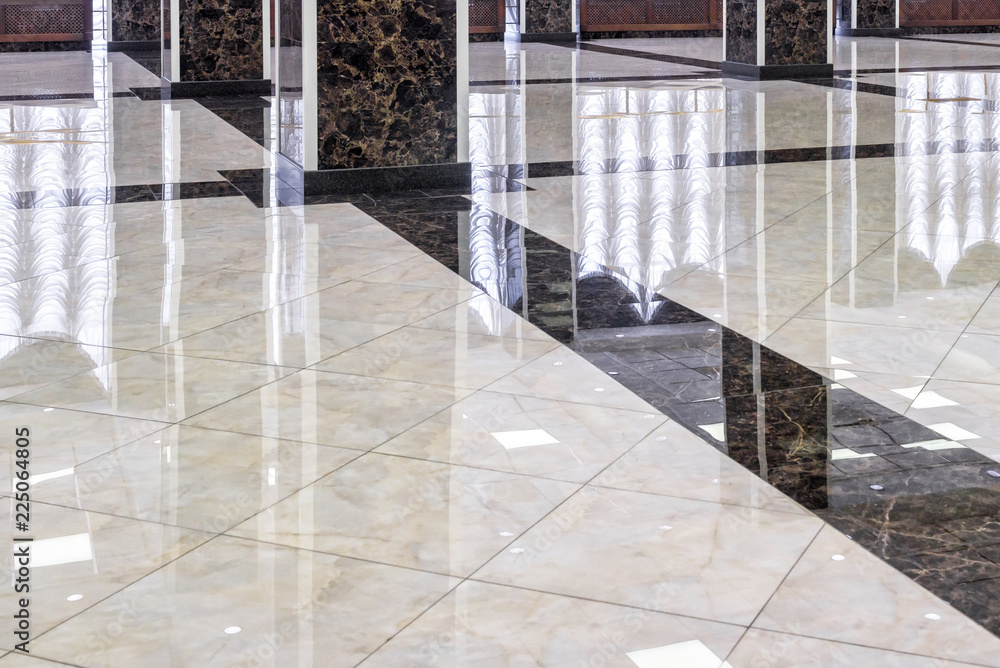 Fototapeta Clean shiny marble floor in commercial office, cleaning service concept