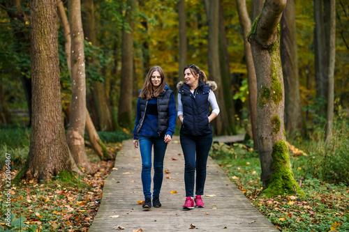 Fotografie, Obraz  People walking in city park