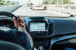 Dashboard View And GPS Map Of Modern Car With Hands Of Man Driver On Steering Wheel