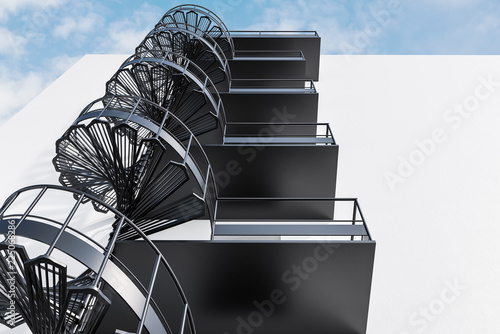 Spoed Foto op Canvas Stad gebouw White building with gray spiral fire escape stairs
