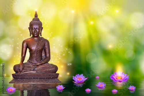 Foto op Plexiglas Boeddha Buddha statue water lotus Buddha standing on lotus flower on orange background